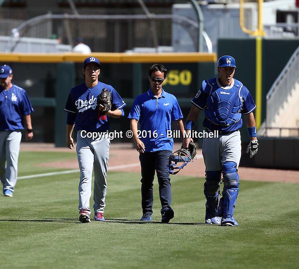 Kenta Maeda (far left), A.J. Ellis (far right) - Los Angeles Dodgers 2016 spring training (Bill Mitchell)