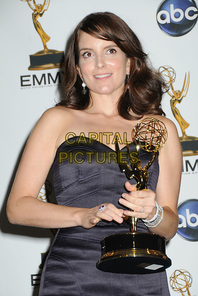 TINA FEY.60th Annual Primetime Emmy Awards held at the Nokia Theatre, Los Angeles, California, USA..September 21st, 2008.pressroom press room half length black strapless dress award trophy bracelet.CAP/ADM/BP.©Byron Purvis/AdMedia/Capital Pictures.