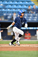 Asheville Tourists center fielder Manny Melendez (19) swings at a pitch during a game against the Greensboro Grasshoppers at McCormick Field on April 27, 2017 in Asheville, North Carolina. The Tourists defeated the Grasshoppers 8-5. (Tony Farlow/Four Seam Images)