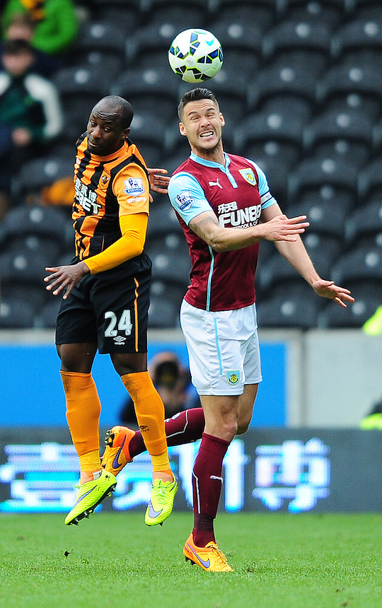 Burnley's Jason Shackell vies for possession with Hull City's Sone Aluko<br /> <br /> Photographer: Chris Vaughan/CameraSport<br /> <br /> Football - Barclays Premiership - Hull City v Burnley - Saturday 9th May 2015 - Kingston Communications Stadium - Hull<br /> <br /> &copy; CameraSport - 43 Linden Ave. Countesthorpe. Leicester. England. LE8 5PG - Tel: +44 (0) 116 277 4147 - admin@camerasport.com - www.camerasport.com