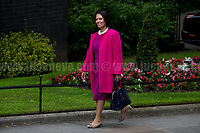 Priti Patel MP (Secretary of State for International Development).<br /> <br /> London, 12/06/2017. Today, Theresa May's reshuffled Cabinet met at 10 Downing Street after the General Election of the 8 June 2017. Philip Hammond MP - not present in the photos - was confirmed as Chancellor of the Exchequer. <br /> After 5 years of the Coalition Government (Conservatives &amp; Liberal Democrats) led by the Conservative Party leader David Cameron, and one year of David Cameron's Government (Who resigned after the Brexit victory at the EU Referendum held in 2016), British people voted in the following way: the Conservative Party gained 318 seats (42.4% - 13,667,213 votes &ndash; 12 seats less than 2015), Labour Party 262 seats (40,0% - 12,874,985 votes &ndash; 30 seats more then 2015); Scottish National Party, SNP 35 seats (3,0% - 977,569 votes &ndash; 21 seats less than 2015); Liberal Democrats 12 seats (7,4% - 2,371,772 votes &ndash; 4 seats more than 2015); Democratic Unionist Party 10 seats (0,9% - 292,316 votes &ndash; 2 seats more than 2015); Sinn Fein 7 seats (0,8% - 238,915 votes &ndash; 3 seats more than 2015); Plaid Cymru 4 seats (0,5% - 164,466 votes &ndash; 1 seat more than 2015); Green Party 1 seat (1,6% - 525,371votes &ndash; Same seat of 2015); UKIP 0 seat (1.8% - 593,852 votes); others 1 seat. <br /> The definitive turn out of the election was 68.7%, 2% higher than the 2015.<br /> <br /> For more info about the election result click here: http://bbc.in/2qVyNRd &amp; http://bit.ly/2s9ob51<br /> <br /> For more info about the Cabinet Ministers click here: https://goo.gl/wmRYRd