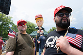 "Motomoto and Christopher Casey, both of Brooklyn, New York, exchanged words with people who turned out to view the ""Baby Trump"" blimp and the Trump Tweeting statue in Washington D.C. on July 4, 2019.<br /> <br /> Credit: Stefani Reynolds / CNP"