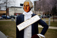 "A George Washington cutout stands with a message reading ""First we need a Department of Peace. If we are able to develop expertise only in war, that is what we shall have,"" at the Occupy New Hampshire and Occupy the Primary gathering in Veterans Memorial Park in Manchester, New Hampshire on Jan. 7, 2012.  The New Hampshire GOP presidential primary is on Jan. 10."