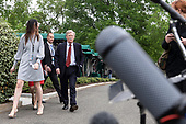 United States National Security Advisor Ambassador John Bolton walks on the driveway with aids after speaking with members of the media in the West Wing driveway of the White House in Washington, D.C. on May 1, 2019. Bolton briefed the media members on the ongoing situation in Venezuela. Credit: Alex Edelman / CNP
