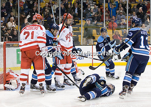 Brian Flynn (Maine - 10), Matt Mangene (Maine - 57) and Spencer Abbott (Maine - 13) skate to Joey Diamond (Maine - 39) who was dumped to the ice by Patrick MacGregor (BU - 4) after scoring. - The University of Maine Black Bears defeated the Boston University Terriers in their Hockey East semi-final 5-3 (EN) on Friday, March 16, 2012, at TD Garden in Boston, Massachusetts.