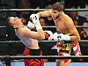 The head of Michael Finney, left, snaps backward after taking a hard hit from Prichard Colon in the second round of a Premier Boxing Champions match at the Barclays Center on Saturday, August 1, 2015. Colon won the bout moments later by TKO. <br />