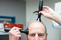 Dr. Charles Welch demonstrates unilateral placement of treatment electrodes in electroconvulsive therapy (ECT) in a treatment room in the ECT and TMS Unit at McLean Hospital in Belmont, Massachusetts, on Mon., Dec. 12, 2016. Welch is an Attending Psychiatrist at McLean Hospital and an Assistant Professor of Psychiatry at Harvard Medical School Teaching Hospital and a leading practitioner of ECT. Kitty Dukakis, wife of former Massachusetts governor Michael Dukakis, is a patient of Dr. Welch.