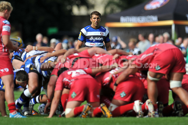 Gavin Henson watches a scrum. Pre-season friendly match, between Bath Rugby and the Scarlets on August 16, 2014 at the Recreation Ground in Bath, England. Photo by: Patrick Khachfe / Onside Images