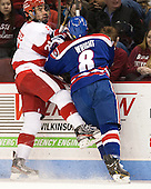 Sean Escobedo (BU - 21), Colin Wright (UML - 8) - The visiting University of Massachusetts Lowell River Hawks defeated the Boston University Terriers 3-0 on Friday, February 22, 2013, at Agganis Arena in Boston, Massachusetts.