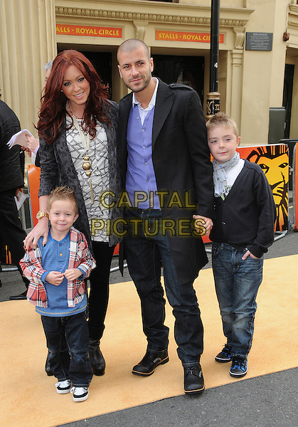 HARRY HATCHER, NATASHA HAMILTON, RIAD ERRAJI & JOSH COSGRAVE.10th Anniversary Performance of 'The Lion King' at the Lyceum Theatre, London, England, UK, .October 18th 2009..full length married couple family sons brothers mother mum mom step-father white top black leggings children kids grey gray leopard animal print cardigan husband wife  .CAP/CAS.©Bob Cass/Capital Pictures