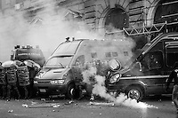 The entrance of the Ministry of Economy is attacked by a group of rioters, some of whom threw crude homemade explosive devices and others who took part in acts of vandalism. Rome, Italy. 09/10/2013