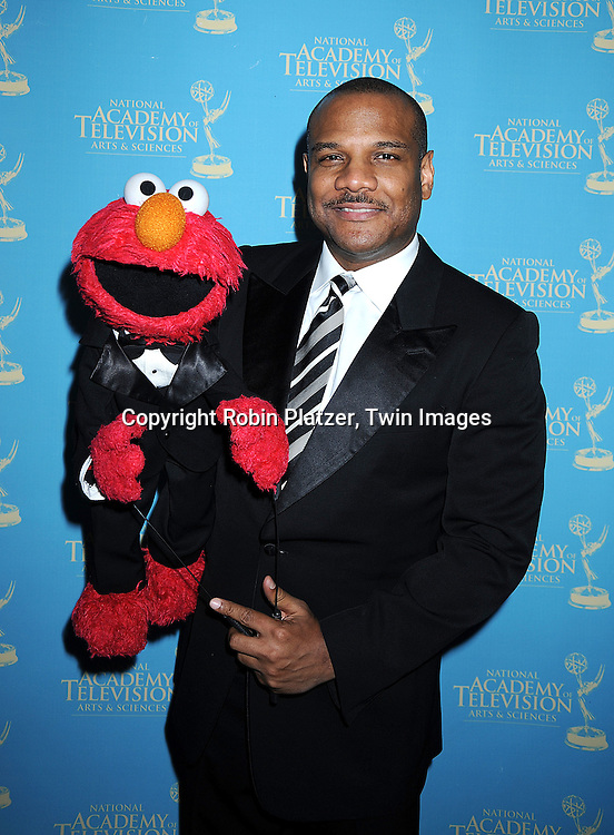 Elmo and Kevin Clash..posing for photographers at The 35th Annual Creative Arts & Entertainment Daytime Emmy Awards on June 13, 2008 at Rose Hall in Lincoln Center in New York City.....Robin Platzer, Twin Images