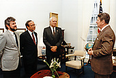 United States President Ronald Reagan meets with (from left) Alfonso Robelo, Arturo Cruz, and Adolfo Calero, three of the leaders of the Nicaraguan democratic resistance (the Contras), at the White House on April 4, 1985.  The meeting was held in the office of National Security Advisor Robert McFarlane.<br /> Mandatory Credit: Pete Souza / White House via CNP