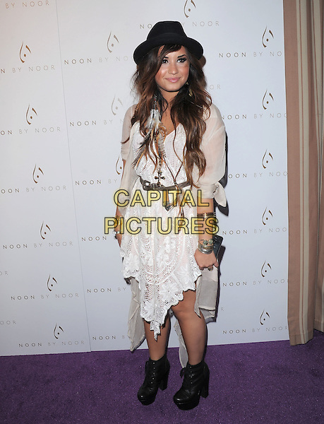 Demi Lovato.The Noon by Noor launch event at At the Sunset Tower in West Hollywood, California, USA..July 20th, 2011         .full length white dress black hat sheer lace ankle boots necklaces .CAP/RKE/DVS.©DVS/RockinExposures/Capital Pictures.