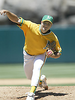 Cory Lidle of the Oakland Athletics pitches during a 2002 MLB season game against the Los Angeles Angels at Angel Stadium, in Anaheim, California. (Larry Goren/Four Seam Images)