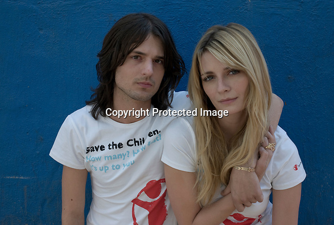 ALEXANDRA, SOUTH AFRICA - SEPTEMBER 2: Mischa Barton, the actress and model stands with her boyfriend Taylor Locke (the lead guitarist in the band Rooney) outside Hlayisanani Pre-School on September 2, 2008 in Alexandra, outside Johannesburg, South Africa. Mischa Barton spent 2 days visiting Save The Children supported projects in South Africa, meeting school children and young children. Save The Children are helping about 51,000 children made by HIV/AIDS and poverty to access food, healthcare, social security and education. (Photo by Per-Anders Pettersson/Getty Images For Save The Children).