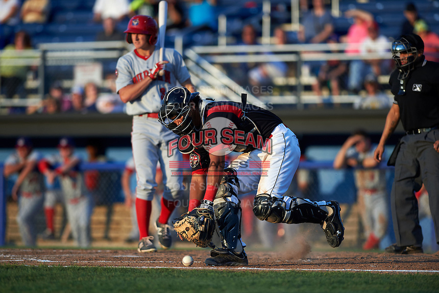 Batavia Muckdogs catcher Brad Haynal (23) retrieves a blocked pitch as Andrew Stevenson (3) and umpire David Martinez look on during a game against the Auburn Doubledays July 10, 2015 at Dwyer Stadium in Batavia, New York.  Auburn defeated Batavia 13-1.  (Mike Janes/Four Seam Images)