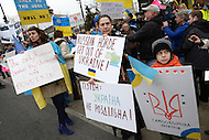 Washington, DC - March 2, 2014: Iryna Yasinska-Graves (c) and her son Danylo join other Ukrainian-American protestors across from the Russian Embassy in Washington March 2 to support peace in the Ukraine. The Russian parliament approved military action in the region the previous day. (Photo by Don Baxter/Media Images International)