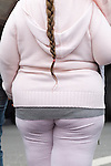 Fat child obesity obese fat overweight torso young girl. England