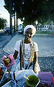 Salvador, Bahia State, Brazil. Woman selling acaraje.