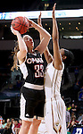SIOUX FALLS, SD - MARCH 6:  Remy Davenport #33 from University of Omaha shoots over Shaquira Scott #25 from IUPUI during their game Sunday at the 2016 Summit League Tournament. (Photo by Dave Eggen/Inertia)