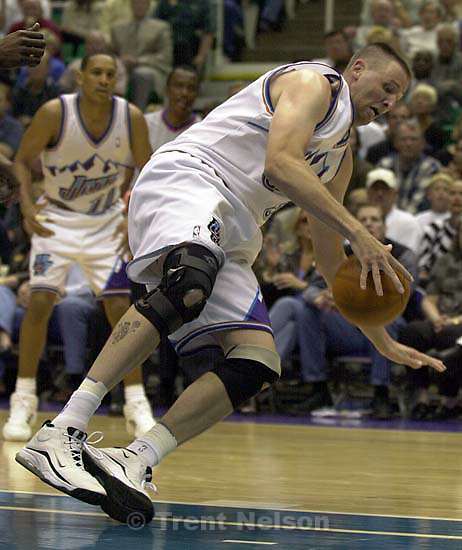 Greg Ostertag falls at Jazz vs. Sonics, game 5, 1st round NBA playoffs. Jazz won.<br />