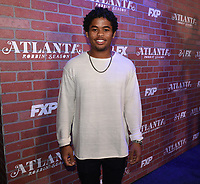 """LOS ANGELES - FEBRUARY 19: Isaiah John arrives at the red carpet event for FX's """"Atlanta Robbin' Season"""" at the Ace Theatre on February 19, 2018 in Los Angeles, California.(Photo by Frank Micelotta/FX/PictureGroup)"""
