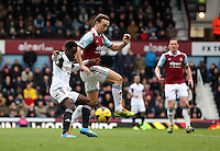 Pictured L-R: Nathan Dyer of Swansea against Mark Noble of West Ham. 01 February 2014<br />