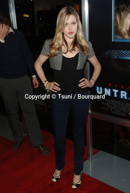 Majandra Delfino arriving at the UNTRACEABLE Premiere at the Silver Screen Theatre In Los Angeles.<br /> <br /> full length<br /> eye contact