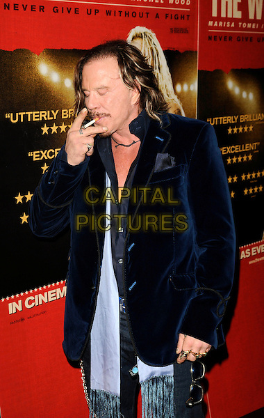 "MICKEY ROURKE .UK Gala Screening of ""The Wrestler"" at Vue West End, London, England,  January 5th 2009..half  length sunglasses moustache mustache facial hair navy blue velvet jacket black necklace belt shirt chest cigarette smoking  scarf tassels .CAP/CAN.©Can Nguyen/Capital Pictures"