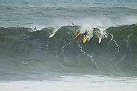 """Waimea Bay, Haleiwa, Oahu, Hawaii (Thursday January 20, 2011) Clyde Aikau (HAW) and Mark Mathews (AUS)..George Downing (HAW) , Contest Director of The Quiksilver In Memory of Eddie Aikau,has called a """"NO GO"""" for competition at Waimea Bay today, based upon the inconsistency of the swell. While there were definitely 20- to 25-foot waves sporadically throughout the morning, the consistency of those large waves was deemed to be insufficient to run the two rounds of competition. The event still has until February 28 to run...""""What we see in conditions like this is just one or two true 'Eddie' size waves in the period of a heat,"""" said Downing. """"With seven surfers in the water per heat, that is not the kind of playing field we need for quality, fair competition...""""It's very easy to get caught up in the excitement when those huge waves come through, and after all of the efforts of the crew and the spectators to get ready for this day. But what keeps this event the greatest big wave event in the world is never relaxing those standards. Eddie never did...""""We will continue to wait. The holding period runs through February 28 and we know that there is definite potential in the coming weeks for more extra large surf to arise. If that day comes, we will be ready to go again...The 15,000-strong crowd that had gathered under moonlight since the very early hours of the morning understood the call and settled in for the day, regardless. With the world's best big wave riders making the most of the opportunity to put some time in at Waimea, they will be treated to spectacular rides throughout the day, without question...2002 Eddie winner and 10X world champion Kelly Slater was in firm agreement with the decision: """"It's a good call."""" said Slater. """"There are big waves out there, but there's not that many of them. It's not what we need..Photo: joliphotos.com"""