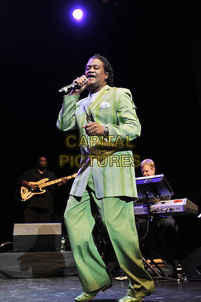The Stylistics performing live in concert, indigo2, Greenwich, London, England. 1st December 2011.stage live gig performance music on full singing length green stripe suit.CAP/MAR.© Martin Harris/Capital Pictures.