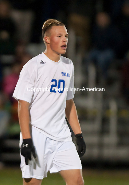 FARMINGTON, CT--- -111815JS05--Lewis Mills'  Frederick Marinelli (20) walks off the field after getting his second yellow card during their Class M. semifinal game against Tolland Wednesday at Tunxis Mead Sports Complex in Farmington. <br /> Jim Shannon Republican-American