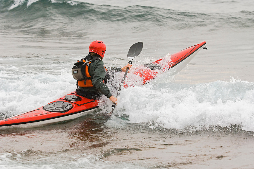 A sea kayaker paddles in rough conditions on Lake Superior near Marquette Michigan.