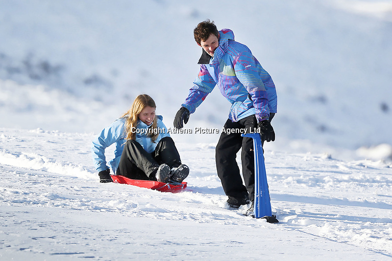 Pictured: A young man and a woman on sleighs at Storey Arms in the Brecon Beacons, Wales, UK. Monday 11 December 2017<br /> Re: Freezing temperatures, snow and ice has affected parts of the UK.