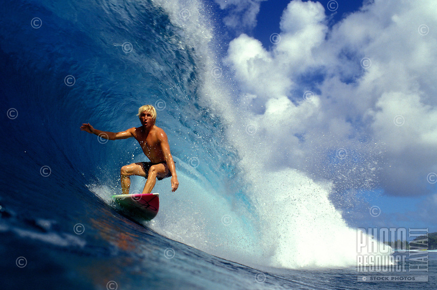 Chris Billy surfing the large waves of the North Shore