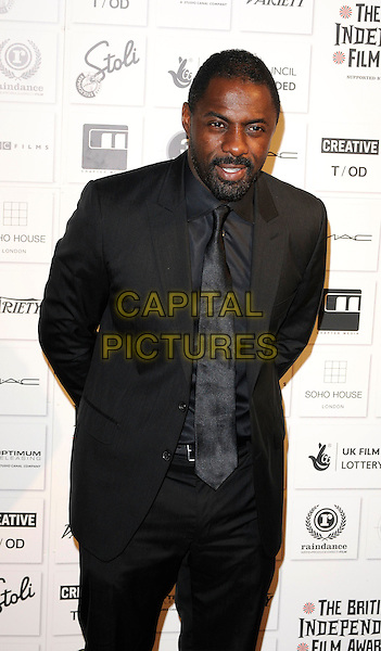IDRIS ELBA .Attending The British Independent Film Awards,The Brewery, London, England, UK, December 6th 2009. .half length black suit tie beard facial hair .CAP/CAN.©Can Nguyen/Capital Pictures.