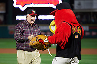 "Rochester Red Wings special guest, actor Dennis Haskins who portrayed High School Principal Richard Belding on the hit TV series ""Saved by the Bell"", shakes hands with mascot Spikes after throwing out the ceremonial first pitch before the second game of a doubleheader against the Scranton/Wilkes-Barre RailRiders on August 23, 2017 at Frontier Field in Rochester, New York.  Rochester defeated Scranton 1-0.  (Mike Janes/Four Seam Images)"