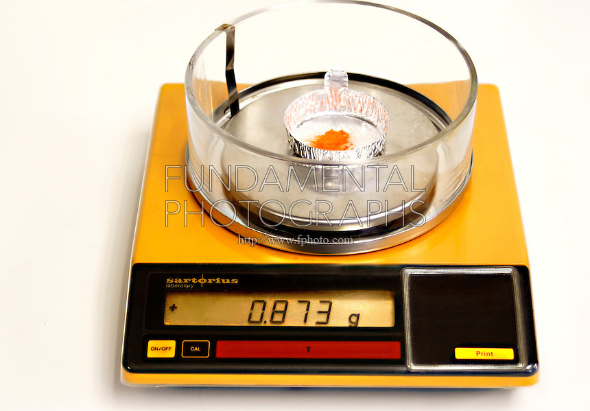 APPROXIMATE MEASUREMENT - WEIGHT<br /> (Variations Available)<br /> 873g Of Potassium Dichromate On A Digital Scale<br /> Potassium Dichromate (also known as Potassium Bichromate or Bichromate of Postash) is measured approximately on a balance with digital display.
