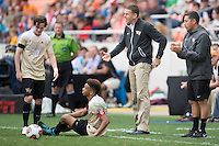 Houston, TX -  Sunday, December 11, 2016: Wake Forest Demon Deacons Head Coach, Bobby Muuss complains to the referee after a Stanford Cardinal player knocked Jacori Hayes (8) down in the first half at the  NCAA Men's Soccer Finals at BBVA Compass Stadium.