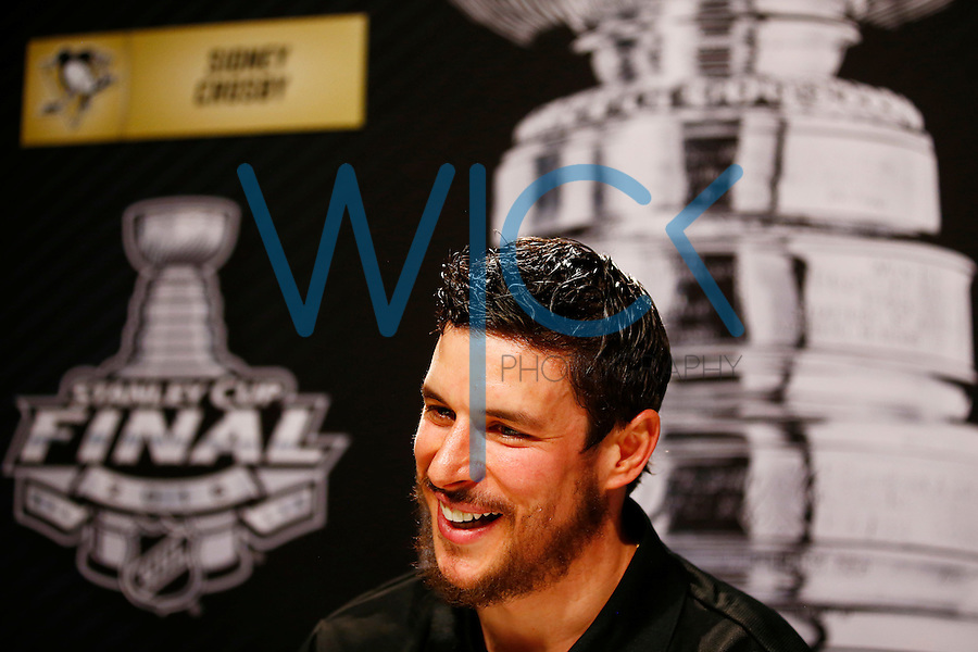 Sidney Crosby #87 of the Pittsburgh Penguins speaks during media day prior to the start of the Stanley Cup Final series between the Pittsburgh Penguins and the San Jose Sharks at Consol Energy Center in Pittsburgh, Pennslyvania on May 29, 2016. (Photo by Jared Wickerham / DKPS)
