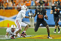 STANFORD, CA - January 2, 2012: Oklahoma State wide receiver Justin Blackmon (81) competes against Stanford at the Fiesta Bowl at University of Phoenix Stadium in Phoenix, AZ. Final score Oklahoma State wins 41-38.