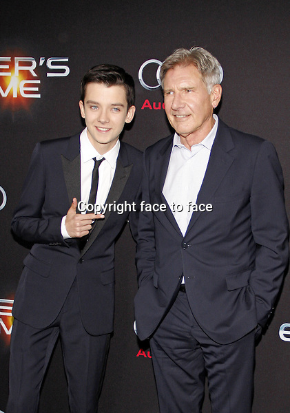 Asa Butterfield and Harrison Ford at the Los Angeles Premiere of &quot;Ender's Game&quot; held at the TCL Chinese Theater in Hollywood on October 28, 2013 in Los Angeles, California.<br /> Credit: PopularImages/face to face