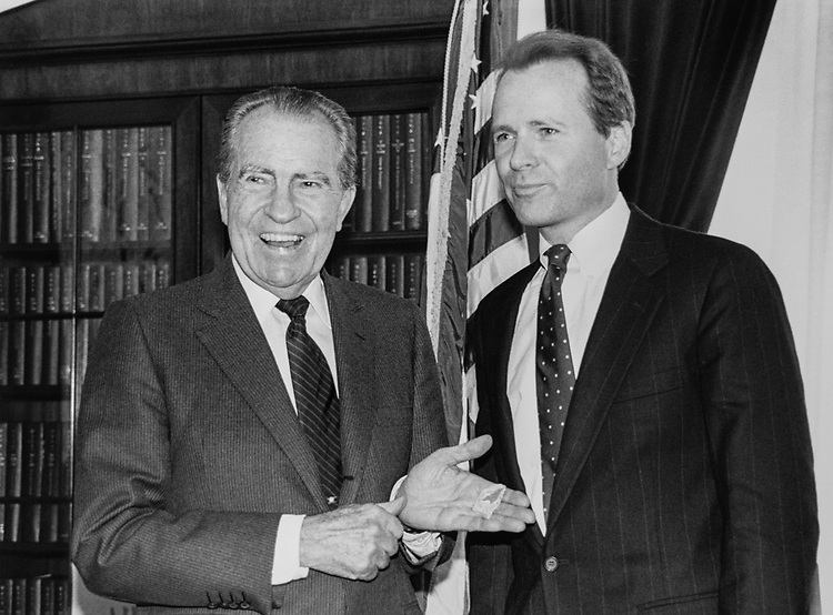 Former President, Richard Nixon and Rep. David Dreier, R-Calif. Rep. Dreier had just presented Nixon with a small piece of the Berlin Wall. Nixon was on the Capitol Hill most of the day, addressing Members of Congress as guest of the Congress Institute regarding Global Changers.  He has private meetings with Rep. Robert H. Michel, Rep. Bob Dole and Rep. David Dreier, on March 8, 1990. (Photo by Maureen Keating/CQ Roll Call via Getty Images)