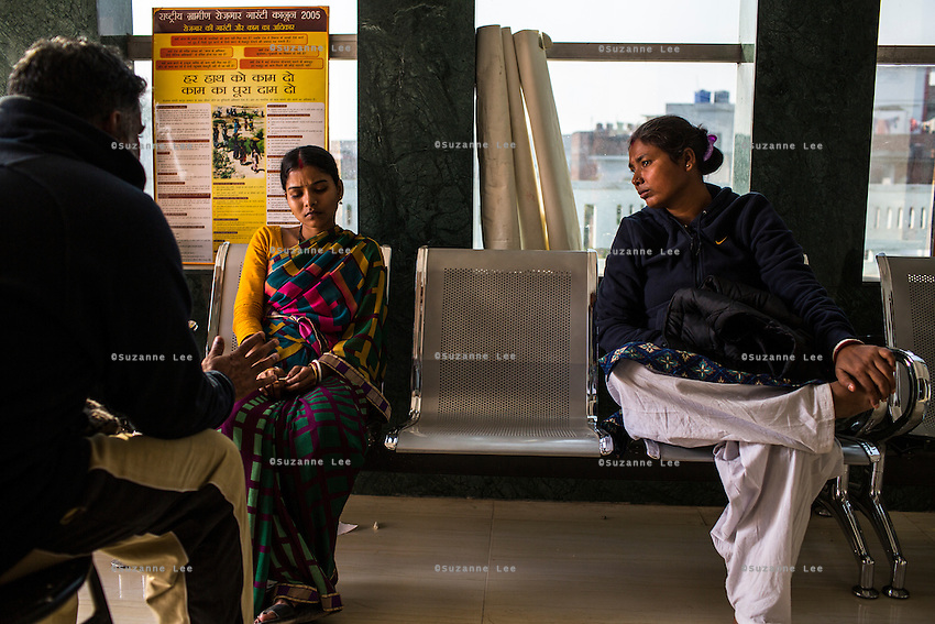 Ajeet Singh, founder of Guria Swayam Sevi Sansthan, and his wife Santwana Manju counsel Brinda in the Guria office in Varanasi, Uttar Pradesh, India on 25 November 2013. She is one of the 57 underaged and trafficked girls rescued from the Shivdaspur red light area in Varanasi, who has been fighting a court case against her traffickers and brothel owners for the past 8 years.