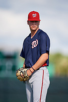 GCL Nationals pitcher Mason Denaburg (16) warms up before a game against the GCL Cardinals on August 5, 2018 at Roger Dean Chevrolet Stadium in Jupiter, Florida.  GCL Cardinals defeated GCL Nationals 17-7.  (Mike Janes/Four Seam Images)