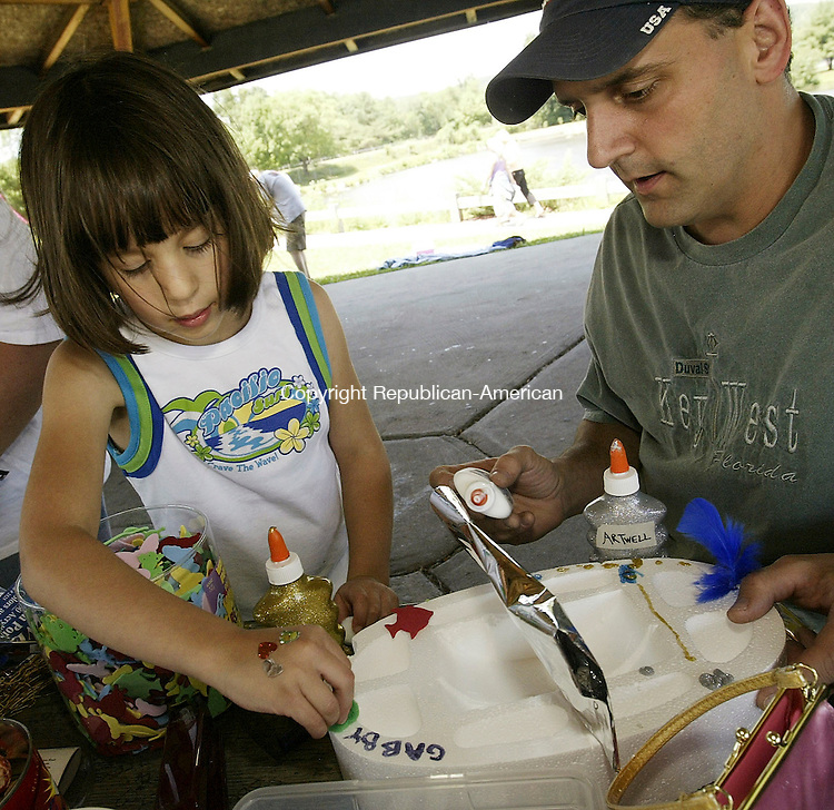 TORRINGTON, CT 10 July 2005 -071005BZ06- Gabrielle Cilfone, 5, of Torrington, left, and her father Tom Cilfone, right<br /> decorate her boat for Artwell's Seventh Annual Floating Artwork Regatta held at Besse Pond in Torrington  Sunday afternoon. <br /> Jamison C. Bazinet Photo