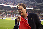 11 July 2004: Chicago Fire general manager Peter Wilt croons into a corner flag before the game. The Chicago Fire tied the New England Revolution 1-1 at Soldier Field in Chicago, IL during a regular season Major League Soccer game..