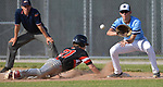 Alton's Nathan Lemons (left) dives back to first base to avoid a pickoff throw to Belleville East first baseman Sam McAnulty in a Class 4A regional semifinal at Alton High School in Alton, IL on Thursday May 23, 2019.<br /> Tim Vizer/Special to STLhighschoolsports.com