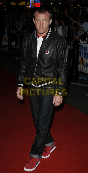 "GUY RITCHIE .""The Firm"" UK Premiere, Vue West End cinema, Leicester Square, London, England. .September 10th, 2009 .full length black jacket  jeans denim rolled turned up red trainers sneakers .CAP/CAN.©Can Nguyen/Capital Pictures."